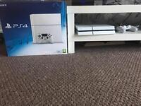 White PlayStation 4 console, with 4 games