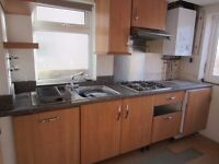 complete kitchen of some wall & floor units complete with a range of appliances