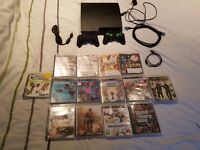 Playstation 3 with 2 controllers and 14 games