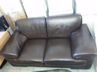 Lovely dark brown leather large two setter sofa. very good condition.