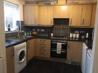 Kitchen cupboards and worktop.