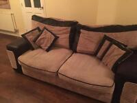 Three seater sofa and revolving armchair with foot stool