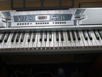 Electronic keyboard full size with stand.VGC.