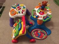 Various VTech baby toys and walker