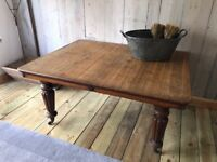 Oak top antique table with brass casters