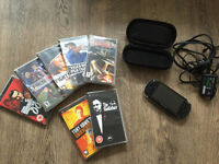 PSP (PlayStation Portable) with travel case, charger, memory card and 7 games