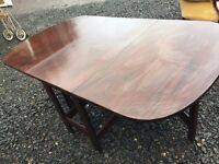 Beautiful Victorian mahogany drop leaf dining table with brass castor wheels