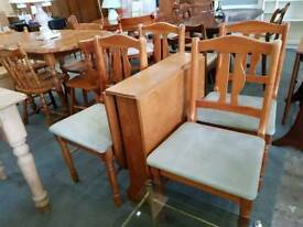 Dropleaf table with four chairs
