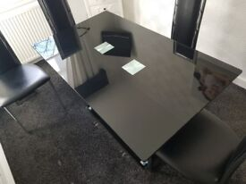 black glass dining table with 4 chairs