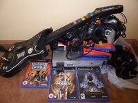 PS2 with Guitar Hero, Singstar and games