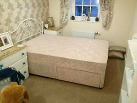 Double bed with mattress and underbed storage.