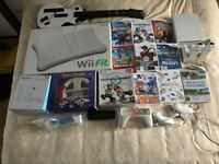 Superb Wii Fit Console Bundle including Board and Guitar