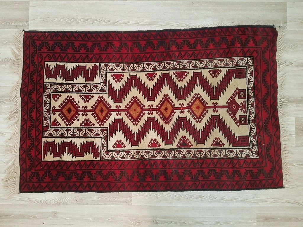 An Eastern rug the cream field with red