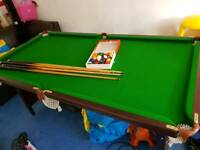 Pool table folding with balls and cues. Collection leagrave