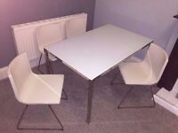 4 chairs (white leather) + dining table (white glass). IKEA price £530. Like new. I will deliver!