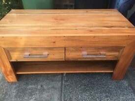 Lovely unusual solid wood well made coffee table with 2 draws and shelf