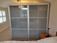 Wardrobes with sliding frosted glass doors with variety of hanging space, shelves and shoe rack