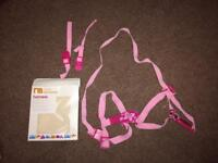 Baby harness in pink, with box, adapters and instructions.