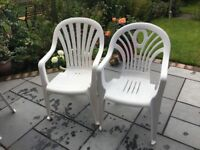 4 white plastic garden chairs in excellent condition.