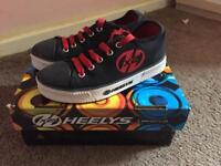 Heelys size 2 with padding and spares