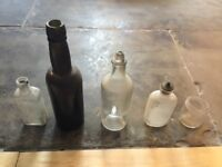 Collection of 5 old glass bottles
