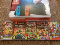 Nintendo switch plus 5 top games excellent condition