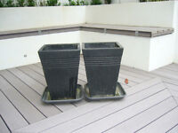 Two Large matching plant pots with trays. Grey/Black blown plastic. 35x35x50 cm