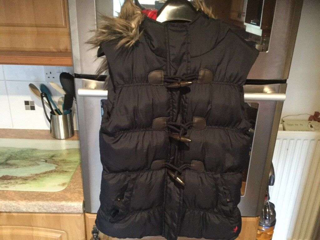 Size 8 ladies gillet with zip, toggles and removable fur on lined hood. IMMACULATE CLEAN CONDITION.