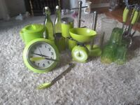 Apple green kitchen utensils including kettle, scales clock etc