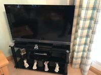 Sony tv and black glass and chrome stand