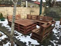 Wooden pallets garden furniture, blankets and pillows and hanging umbrella