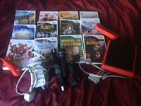 Red Wii mini and 12 mixed mainly music games. Good condition.