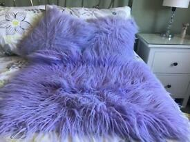 Purple pillows and rug