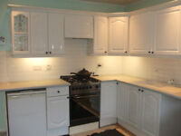 Kitchen units, doors and knobs with sink, taps, extractor fan, waste disposal unit.