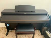 Roland HP102e digital piano