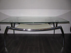 Metal frame coffee table with glass top.