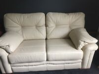 Three piece cream leather suite. Consists of a three seater, two seater and an armchair.