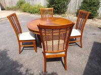 Rattan dining room table and four chairs, need cleaning, restoring, repairs