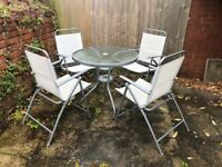 Garden furniture set with 4 chairs, glass table and unused parasol
