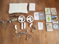 Nintendo Wii with accessories including balance board