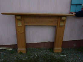 Pine fireplace 115 cm high with mantel, 130 cm wide at base and 165 cm wide with mantel