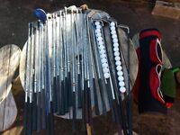 Range of golf putters, drivers, wedges, balls and caddy.