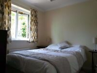 Double room in peaceful house, with off road parking, located near M5