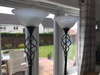 Two dark brown standard lamps