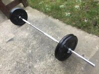 SOLID BARBELL WITH 40KG OF YORK CAST IRON WEIGHTS