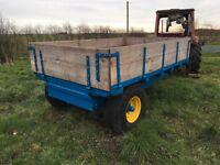 Refurbished tipping cart farm trailer.