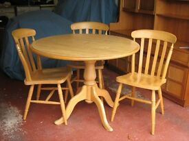 Table and 4 chairs, light oak effect.