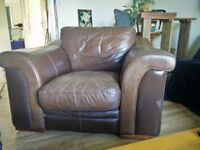 Leather armchair worn-in, not worn-out. Well made and comfortable. Buyer collects