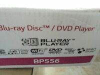 LG BP556 3d blu-ray player new in box never used with remote and instructions