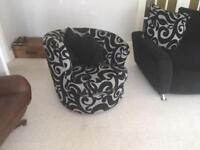 Black and grey sofa and matching swivel armchair